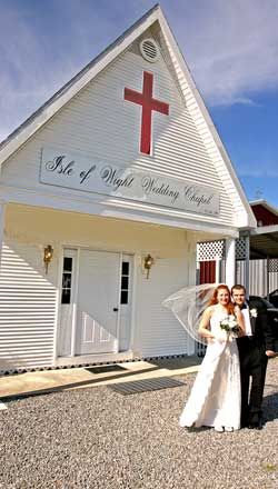 Couple outside of Isle of Wight Wedding Chapel